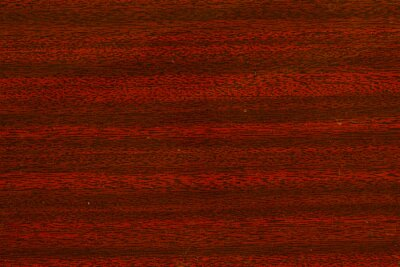 Brown varnished red tree wooden desk surface original texture.