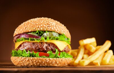 Naklejka burger and french fries on wooden table