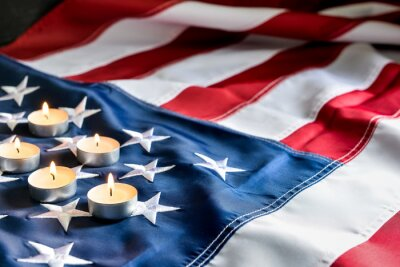 Naklejka Burning candles on USA flag. National Day of Prayer and Remembrance for the Victims of the Terrorist Attacks