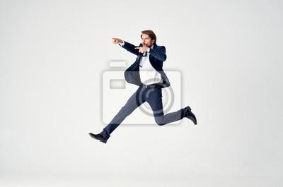 Naklejka businessman jumping in the air