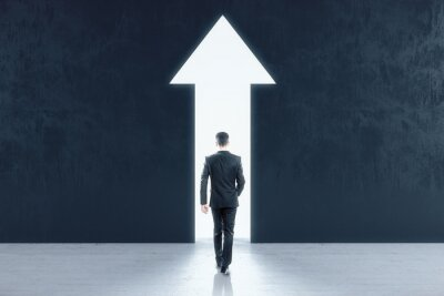 Naklejka Businessman walking to abstract white arrow