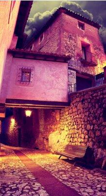 Naklejka Calle de pueblo al Anochecer con Faroles y Banco