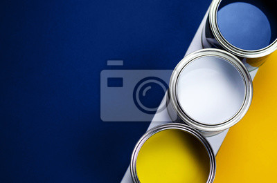 Naklejka Cans of paint on a background of yellow and classic blue.