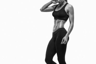 Naklejka Centrum sportowy kobieta pokazano jej dobrze wyszkolonych ciało