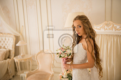 charming beautiful bride holding wedding bouquet in her hands