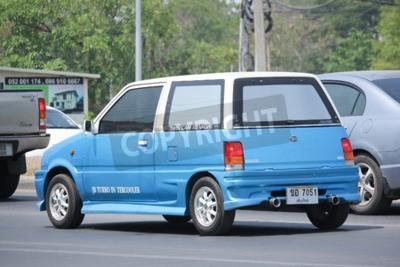 Naklejka Chiangmai, Tajlandia -APRIL 26 2016: Prywatny samochód Daihatsu Cuore. Zdjęcie przy drodze nr 121 około 8 km od centrum Chiang Mai w Tajlandii.