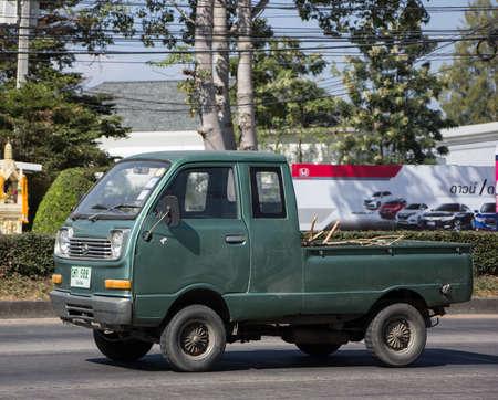 Naklejka Chiangmai, Thailand - December 15 2020: Private Mini Truck of Daihatsu Hijet. On road no.1001 8 km from Chiangmai city.