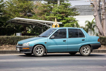Naklejka Chiangmai, Thailand - February  9 2021: Private Old Car Daihatsu Charade. Photo at road no 121 about 8 km from downtown Chiangmai, thailand.