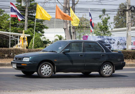 Naklejka Chiangmai, Thailand - March  5 2020: Private Old Daihatsu Applause Car. Photo at road no 121 about 8 km from downtown Chiangmai, thailand.