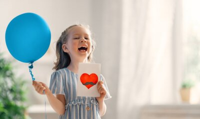 child with air balloon and postcard