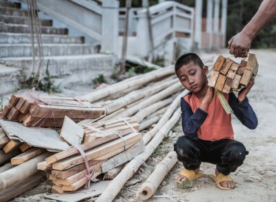 Naklejka Children are forced to work in construction areas. Human rights concepts, December 10 Stop child abuse, violence, fear of child labor and human trafficking.
