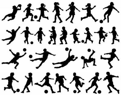 Naklejka Children playing soccer vector silhouettes