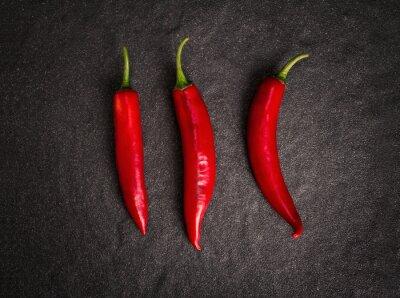 Naklejka chili pepper on black stone background