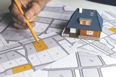 Naklejka choose a building plot of land for house construction on cadastral map