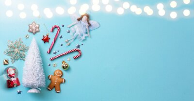Christmas light blue background with Christmas Tree decoration;  holiday greeting banner flat lay