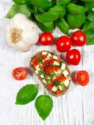 Naklejka Ciabatta z pomidorami, mozzarellą i bazylią.