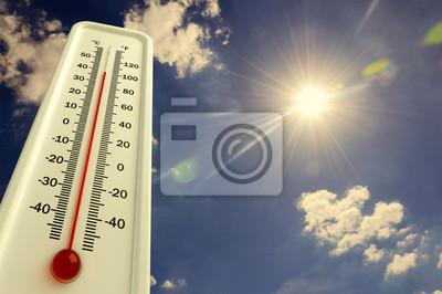 Naklejka Ciepło, termometr pokazuje temperaturę na niebie, lato
