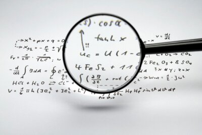 Naklejka Close-up Of Magnifying Glass Over Mathematics Solution