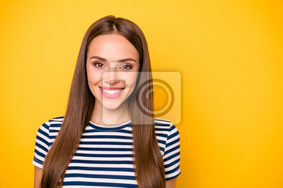 Close up photo of charming lady looking at camera smiling wearing striped t-shirt isolated over yellow background