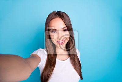 Close up photo of cheerful person making photos looking isolated over blue background
