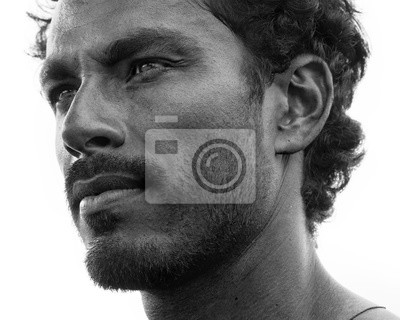 Naklejka Close up portrait of healthy man with black hair, strong features, looking straight ahead at a three quarters angle, black and white