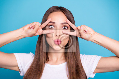 Close-up portrait of nice attractive lovely girlish cheerful cheery funny funky straight-haired lady showing double v-sign fooling isolated over bright vivid shine blue green teal turquoise background