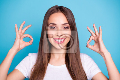 Close-up portrait of nice attractive lovely positive cheerful cheery content straight-haired lady showing two double ok-sign isolated over bright vivid shine blue green teal turquoise background