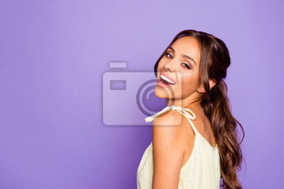 Close-up profile side view portrait of her she nice attractive stunning lovable fascinating magnificent winsome cheerful cheery wavy-haired girl isolated over violet pastel background