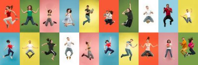 Naklejka Collage of portraits of 11 young jumping people on multicolored background in motion and action. Concept of human emotions, facial expression, sales. Smiling, cheerful, happy. Using devices, gadgets.