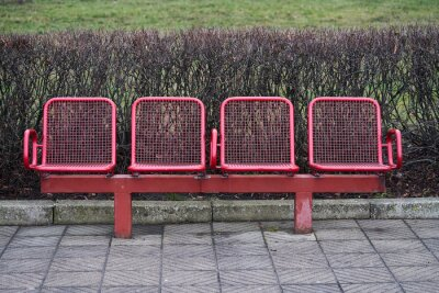 colored metal bench at a tram bus train stop