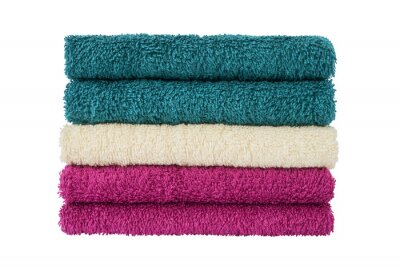 Colorful bath towels in stack isolated over white background with clipping path.