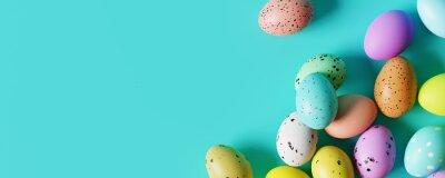 Naklejka Colorful Easter eggs on pastel blue background. Creative design. 3d rendering