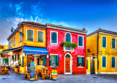Naklejka colorful houses in a raw at Burano island near Venice Italy. HDR
