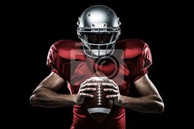 Naklejka Composite obraz Amerykański piłkarz trzyma piłkę