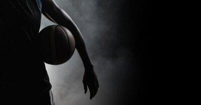 Naklejka Composition of athletic male basketball player over smoke on black background