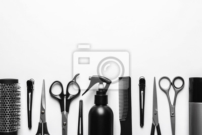 Naklejka Composition with scissors and other hairdresser's accessories on white background, top view