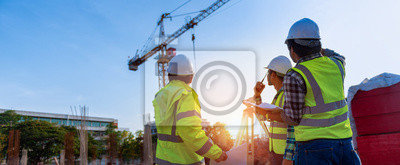 Naklejka Construction engineers discussion with architects at construction site or building site of highrise building with Surveying for making contour plans is a graphical representation of the lay in land.