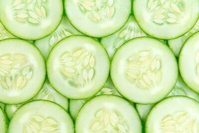 Naklejka Cucumber slices background