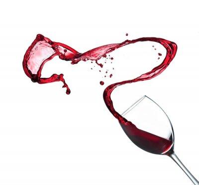 Naklejka Czerwone wino rozpryskiwania ze szkła, na białym tle