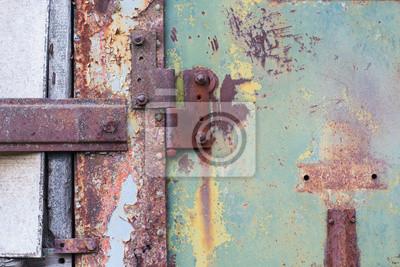 Część zardzewiały metalowe drzwi z zawiasów