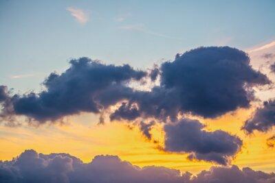 Dark clouds and orange sky at sunset