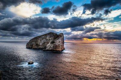 Dark clouds over Foradada island in Capo Caccia shore