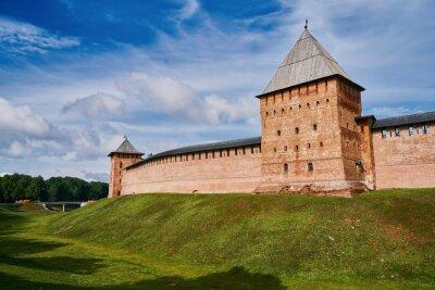Detinets or Novgorod Kremlin red brick fortress walls. Towers of fortress in Novgorod Kremlin in summer day in Veliky Novgorod, Russia. Travel concept
