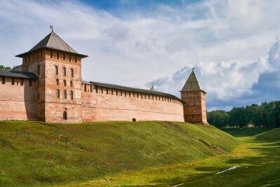 Detinets or Novgorod Kremlin red brick fortress walls. Towers of fortress in Novgorod Kremlin in summer day in Veliky Novgorod, Russia. Travel concept, copy space