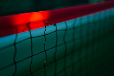 diagonal net of tennis with red stripe in green hard court, tennis compettion concept
