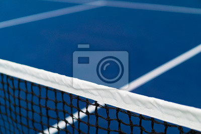 diagonal net of tennis with white stripe in blue hard court, tennis compettion concept