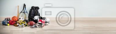 Naklejka Different Type Of Sports Equipment On Wooden Desk