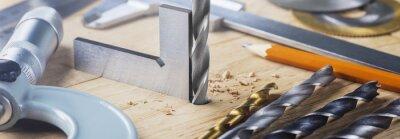 Naklejka drill bit with steel triangle ruler make sink in hole for screw in wooden oak plank