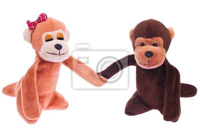 dwa miękkie zabawki monkey