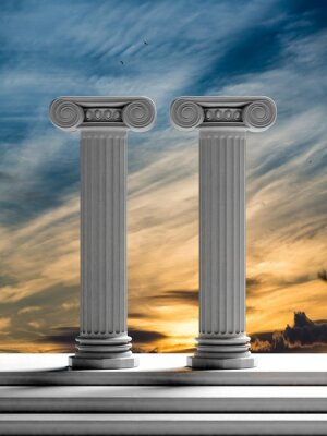 Naklejka Dwa starożytne filary z tle zachodu słońca nieba.